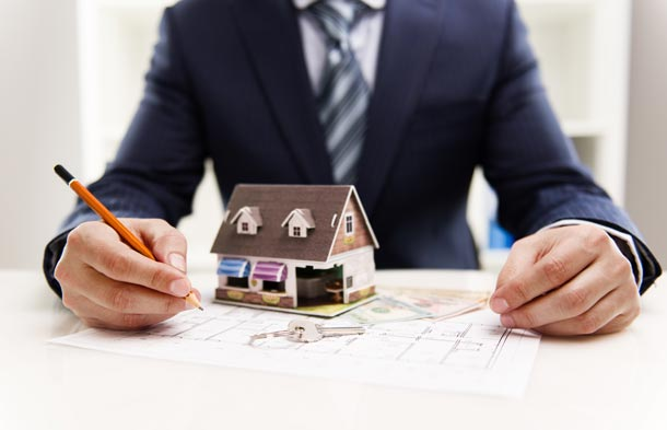 Man Filling Out House Selling Paperwork